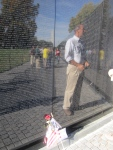 You can see my reflection in the wall as I read a few of the over 58,000 names inscribed in the wall of soldiers either killed or missing in action during the Vietnam War which lasted from 1959-1975.