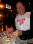 "I had the ""special""  Maine Lobster for dinner in honor of the Maine principal!  The bib ensures that I don't get any of the lobster juice on my clothes.  Dipped in melted butter, yum-yum!"