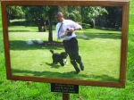 This picture shows the President having fun playing with the First Dog, Bo!  This is the First Families back yard.  Whenever the family is present in the south lawn, the sidewalk circling the lawn is closed and pictures are not allowed to be taken to ensure the families privacy and security.