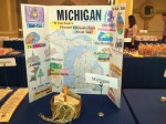 Our Michigan board displayed on a table with the Petoskey Stone artifacts in a basket to share with all of the principals and other guests.